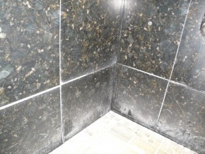 Soap scum and limescale make this gorgeous shower look dinghy