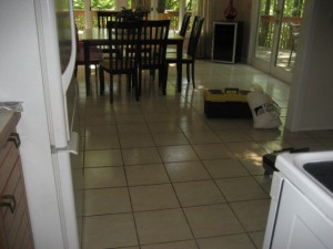 Dirty grout joints break up the spacious feeling of this open kitchen...